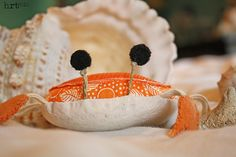 Crabby Pincushion tutorial.  orange is the best color, but make a rainbow or crabbies, or even an army to take over your sewing table.