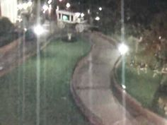 Ghost hangs around Disneyland. This video taken of security camera monitors at Disneyland appears to show a ghost walking around on the grounds at night. What's interesting is that the apparition is captured by multiple cameras, and it seems to walk right Spooky Places, Haunted Places, Scary Stories, Ghost Stories, Ghost Caught On Camera, Spirit Ghost, Ghost Videos, Ghost Walk, Ghost Pictures