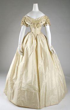 Silk evening dress, front view, American, c.1860. Low body, deep vee at waist; single box pleats in front, hem facing. MET