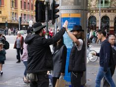 I was really glad I captured this image of two strangers high firving each other as they both noticed that they had similar hats. Would have been a stringer image if there was less people in the background but unfortunately that day was very busy so it was harder to capture those moments without a lot going on in the background.