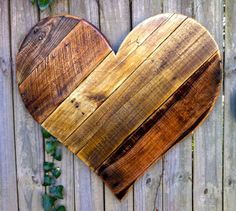 We make this rustic heart by hand from reclaimed lumber. Each board is chosen for its unique character and arranged in a mix of Pine, Poplar, Cedar &