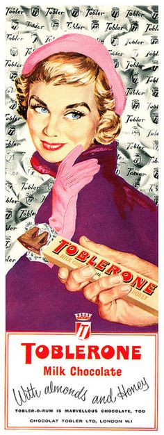 Typical female representation along with the product, in addition to the red product name with a blocky type and curved font. Very typical of 50s vintage style.