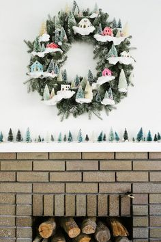Give a hint of whimsy to your mantel with snowy fir trees + a matching wreath.