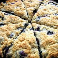 Bisquick Blueberry Scones -     3 cups Bisquick,     2 tbsp. Sugar,     1 cup fresh or frozen blueberries,     1/4 cup milk,     2 eggs,     For Glaze:    1 egg, well beaten,     2 tbsp. Sugar