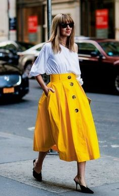 NYFW Street Style, photo from Vogue.co.uk, featuring on Energizing Accent Colours blog post by botanical artist Charlotte Argyrou. Canary yellow. Yellow fashion. Yellow skirt.