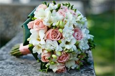 Traditional Round Wedding Bouquet Of Roses and Freesias.