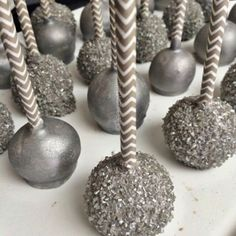 Love this cake pop look! Metallic Cake Pops Displayed on Chevron Paper Straws