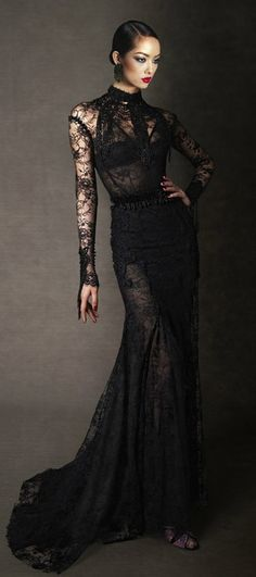 Beautiful, black lace evening gown. It skims the body for an ultra flattering effect. Sultry and mysterious.