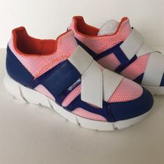 Calvin Klein sneakers new! Brand new leather and elastic. Orange and blue! Super cool sneakers. Have one spot on strap. Comes in box Calvin Klein Shoes Sneakers