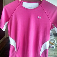 NWOT Under Armour Pink T-Shirt Size Medium Aloha! This item is a NWOT Under Armour athletic shirt in a vibrant link, size women's medium. Light in feel with aerated white material on the sides and under the arms, this shirt will help your perform to your best! Under Armour Tops Tees - Short Sleeve