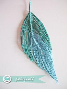 handmade feathers out of embroidery floss or yarn