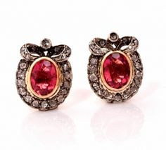 These gorgeous vintage stud earrings are crafted in solid 18K yellow gold with a white gold top and are centered with 2 genuine oval cut tourmalines