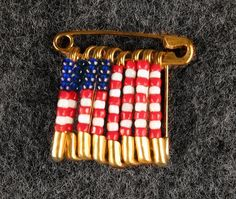 Made soon after September people used safety pin flag jewelry to show their solidarity and patriotism. My fourth grade class raised thousands of dollars by making these Safety Pin Crafts, Safety Pin Jewelry, Safety Pins, American Flag Pin, American Heritage Girls, Summer Crafts, Holiday Crafts, Clothes Pin Wreath, Flag Pins