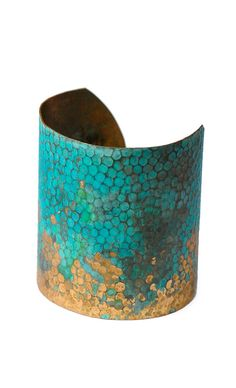 Mermaid Cuff. Paint a tarnished old bracelet turquoise and then sand down one side a bit. Natural wear will do the rest