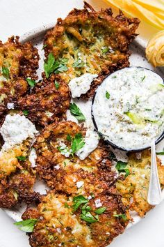 Mediterranean-Style Zucchini Fritters with Tzatziki Dipping Sauce by The Modern Proper Move over zucchini bread—our savory, Italian-ish (hello salty-licious parmesan cheese!), Greek-ish (hello tzatziki sauce for dipping! Vegetarian Recipes, Cooking Recipes, Healthy Recipes, Salad Recipes, Quick Recipes, Easy Cooking, Delicious Recipes, Lebanese Recipes, Haitian Recipes