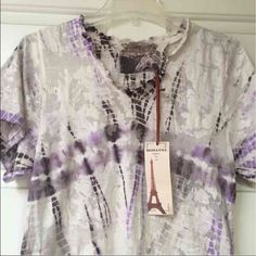 """NWT Tie Dye Boho Tunic Tee Top Adorable! Brand new with tag. Semi sheer burnout fabric with purple and brown tie dye against ivory background. Cute long ruffled bottom. I believe it is 100% cotton, but doesn't specify on tag or label. Bust: 18"""" measured flat, so double - Length: 28"""" Moda International Tops Tees - Short Sleeve"""