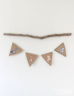 For Jason's baby shower, I cut out the little forest animals and glued them onto some brown craft paper banners I made.    Just draw little sharpie patterns around the borders & strung them up using t