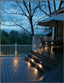 Tiered steps on outdoor deck with lighting