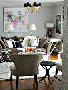 A black and white color scheme is an easy way to achieve classic style when arranging pillows. One thing to keep in mind: prints filled with saturated black tend to read a little bolder than white, so you may want to use mostly black pillows sparingly if the look starts to feel a little overwhelming. Image: Bliss At Home
