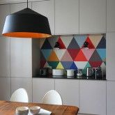 One of the beauties of choosing grey for your kitchen is that it is a neutral shade so you can afford to be bold elsewhere, like the splashback here, which is well-protected wallpaper. This geometric pattern is a striking focal point that really brings something special to the design. http://www.housetohome.co.uk/room-idea/picture/kitchen-splashbacks-our-pick-of-the-best?slideshow=