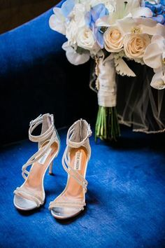 These elegant wedding shoes are perfect for a summer wedding. These shoes are gold open toe heels with glittery straps. Click to see more fun wedding planning ideas! Planning your wedding has never been so easy (or fun!)! WeddingWire has tons of wedding ideas, advice, wedding themes, inspiration, wedding photos and more. {Cassandra Lee & Co.}