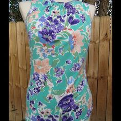 Adorable floral tank by Chaps Made of 95% viscose and 5% elastase, this sleeveless tank is super soft and comfortable. Flirty, feminine floral print with single button closure on the back. In great condition . Chaps Tops Tank Tops