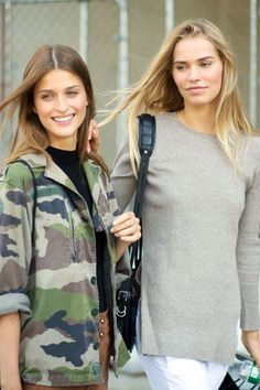 Perfect layers for fall: a camo jacket or a cozy neutral sweater. See all the best NYFW street style here:
