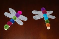 Dragonflies - pom poms, craft sticks, and wings from wax paper.