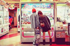 I love this pic.. In Japan they have claw machines of all kinds. They have food in them instead of stuffed animals.. Chips, cokes etc.. It so so different.