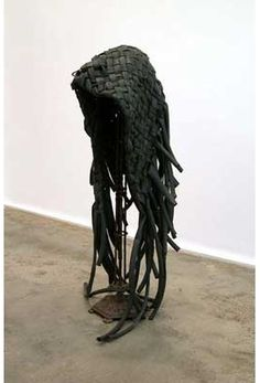 David Hammonds, Rubber Dread, 1989, Rubber bicycle inner tubes, found metal stand and red rubber ball,