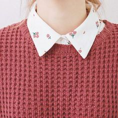 When it gets colder she wears a sweater over her button downs. #buttondowndress