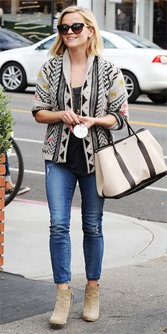 Street Style File: Reese Witherspoon mastered street style cool with a printed knit cardigan over a dark gray top, slightly distressed Koral skinnies, layered gold necklaces, a leather-trimmed canvas carryall and tan ankle boots. #InStyle