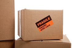 Moving boxes with fragile stickers. Moving boxes with fragile sticker on a white , Office Moving, Moving Day, Fragile Label, Office Plan, Moving Boxes, Moving Services, Packing Tips, Priorities
