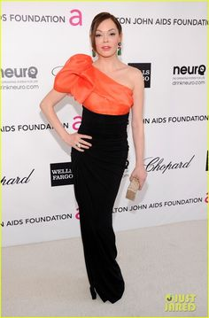 COLOR! + Black Paule Ka gown and Sergio Rossi heels + David Webb jewels and an Edie Parker clutch Elton John Oscar Party