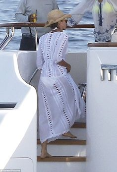 Sheer beauty: The model's white bikini was still visible beneath the kaftan-style number she was wearing