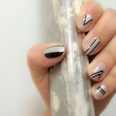 Graphic geometrics = #NailInspo for the weekend!  Our Brand Accelerator created this look using Back to Black, Prayer (solid silver metallic) and Radiance (silver & holographic glitter). Experiment with different line thickness & tag #TeamOndine for a chance to be featured!  Shop Radiance via link & find Back to Black / Prayer using the search function on our site.  #TeamOndine #LittleOndine #nails #summernails #notd #nailswag #toxinfree #peeloff #peelaholic #nailpolish #bblogger