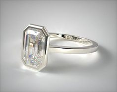 This 14k white gold bezel solitaire engagement ring (emerald center) is available exclusively from JamesAllen.com