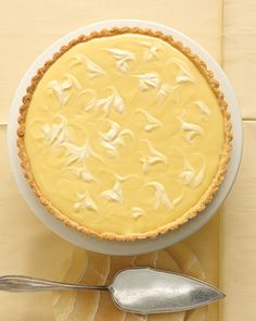 """Marbled Lemon Tart with Sage-Cornmeal Crust:  """"Egg yolks, sugar, and mouth-puckering lemon juice create a velvety curd that is poured into a crunchy cornmeal shell flecked with lemon zest and fresh sage. The tart filling is balanced by the mellow flavor and creamy texture of creme fraiche, which is placed atop the tart in dollops and teased into artistic swirls with a wooden skewer."""""""