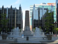 One PPG Place is the name of the main tower, but a collection of 5 shorter buildings of similar design and materials clusters around a square with a fountain in this complex designed by Philip Johnson and John Burgee.