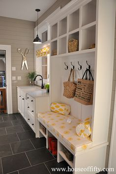 Mudroom, taupe shiplap paneled walls, dark slate floor, white trim. Could add/change colorful accents as desired
