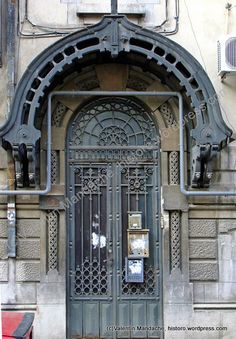 Late 1920s Neo-Romanian style doorway and contemporary gas-pipe, Bucharest