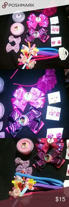Doc Mc stuffins slime and bow lot Here we have our purple and pink doc MC stuffins lot U get everything here  1pink and purple BC bow 1pink and black BC bow 4 stretchy headbands  1set of sparkly bows 1 SRT of cupcake earrings 1set of lollipop earrings 1set of heart pop earrings 1 sparkly flowered headband 1 1.5 oz of pink slime 1 1.5 oz of purple slime Disney Other