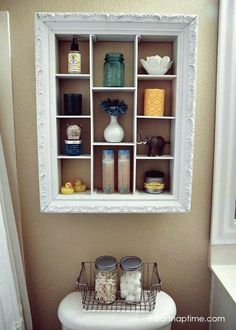 DIY bathroom makeover with an over the toilet storage unit repurposed from an old picture frame. Toilet Storage, Small Bathroom Storage, Diy Bathroom Decor, Bathroom Organisation, Diy Home Decor, Bathroom Ideas, Small Bathrooms, Bathroom Mirrors, Simple Bathroom