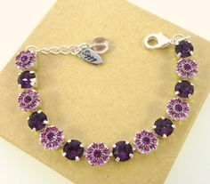 PURPLE DAISY Swarovski crystal flower bracelet, amethyst, 8mm, daisy flowers, Siggy bracelet by SiggyJewelry on Etsy https://www.etsy.com/listing/217523210/purple-daisy-swarovski-crystal-flower