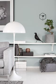 I like the idea of a long wall length shelf rather with floor lamps rather than end tables for more openness