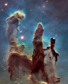 The most iconic photos captured by the 25-year-old Hubble space telescope - Quartz- Pillars of Creation – 6,500 light-years  This was the first shot by Hubble in 1995, and it is arguably the telescope's most iconic snap. The pillars are four-light-year long columns of gas and dust blown outward by a cluster of energetic stars in the Eagle Nebula, and they're also nursing young stars within themselves.