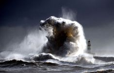 A raging sea dwarfs Seaham Lighthouse in County Durham in England, with 100 ft waves after a cold front moved down from the north bringing freezing temperatures to the North of England. (© Owen Humphreys/National Geographic Traveler Photo Contest) #