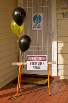 "At the entrance to the party, a saw horse with some yellow & black helium balloons and work sign saying ""Caution Party Zone Ahead"" ... greeted guests so they knew they were at the right ""contruction site/party zone."""