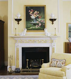 New ideas for old hearths.  http://www.bhg.com/decorating/fireplace/mantels/decorating-ideas-for-old-hearths/#page=3 [ #mantel #mantle #display #ideas #fire #place #fireplace  #cream #white #yellow ]