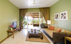 Green Painted Wall Idea And Tropical Living Room Interior Decorating Featured Awesome Wicker Sofa Design